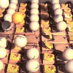 Still of ping pong balls from chain reaction video
