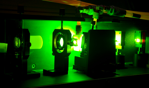 Machinery in dark room emitting green light